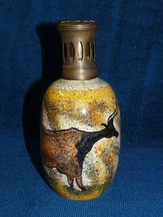 Belle lampe berger ancienne,sur un jolie décor des grottes de Lascaux