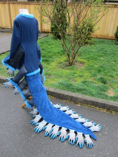 "This is a great idea for a ""Mr. Centipede"" costume for James and the Giant Peach. I wonder whether stitching a jointed chain would structure the movement of the train."