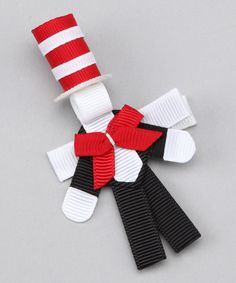 Seussian charm and whimsy come together on this Cat in the Hat clip. Handmade and carefully crafted with sealed ends to prevent fraying, this happy-go-lucky piece will brighten any 'do.