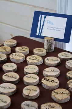 escort cards on wood cookies on back write name of table