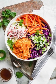 Sesame Soy Ginger dressing jazzes up simple chopped veggies for this delicious Asian Coleslaw recipe. It\'s naturally vegan and gluten-free so it\'s great for any barbecue party, potluck or cookout! #coleslaw #asian #salad #sidedish #summersidedish #summerrecipes