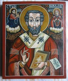 Title: Saint Nicholas . Handmade painting. Icon measures: 29 / 23 / 3cm. Saint Nicholas in a beautiful representation, inspired from Romanian traditional style. This icon doesnt have a gold leaf finish on its surface because the artist balanced very well the colors. The face expression of St