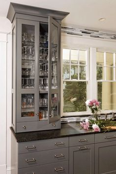 beautiful gray cabinets.... I like the gray, would go with my black corian countertops...