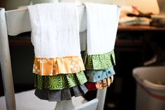 Take cheap towels and add a decorative ruffle or two from my fabric stash!