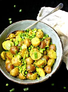 Vegan Potato Salad with Turmeric and Green Peas, and a creamy dressing of ginger, turmeric and coconut milk. Gluten-free, soy-free, nut-free.