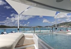 """This 255-foot yacht is touted to be ideal for the charter market because of its 5 decks, 4 VIP staterooms, a large array of toys including jet skis and tenders, and its two pools that even feature a """"swim-up"""" bar."""