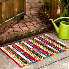 Welcome Mat ~ MDF board, spray paint, fabric, decoupage medium, threaded rods and nuts to fit, exterior varnish.