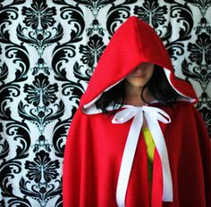 Free PDF Cape Pattern.  Although this is made of fleece, it can be adapted to for any fabric. Also while it looks complicated there is a great tutorial and a video to go with it.  @Danielle Stolworthy too little too late.