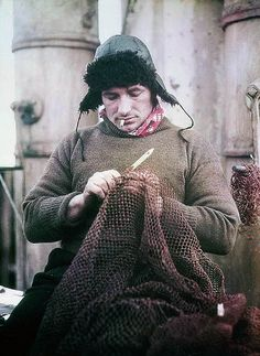 The Bosun John Vincent of the 'Endurance' mending a net, 1915, Frank Hurley, early colour photographs of Shackleton's British Imperial Trans-Antarctic Expedition 1914-1917