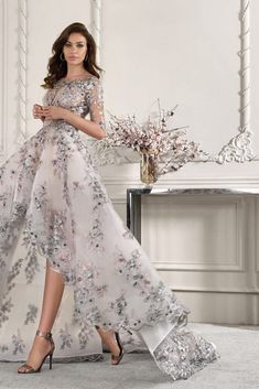 This statement making high-low Organza gown features breathtaking multi colored lace over a Bateau neckline and length sheer sleeves. The low sheer back with lace accents and striking train add the finishing touch. Organza Wedding Gowns, Colored Wedding Dresses, Elegant Wedding Dress, Wedding Dress Styles, Bridal Dresses, Prom Dresses, Dress Wedding, Multicolor Wedding, Moda Chic