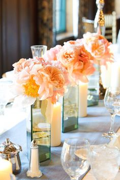 The flowers are slightly brighter than what we're going for, but I like the idea of combining candles and flowers in the centerpieces.