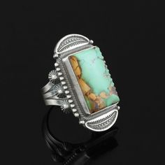 A sterling and turquoise ring made by Native American artist Stanley Parker of the Navajo tribe.