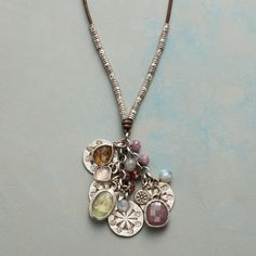 """PLENTITUDE NECKLACE--Sterling silver links, Thai silver beads and supple leather preface a bounty of beauty—stamped sterling charms as well as aquamarine, garnet, prehnite, pink sapphire and rose and cognac quartz, all framed in sterling. Adjustable. Exclusive.  20"""" to 28""""L, 2"""" drop."""