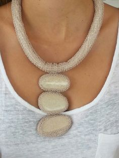 Necklace wire tube with sea pebbles