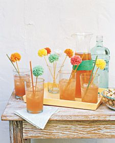 Mexican theme dinner party decor: DIY mini raffia pom-pom flower drink stirs from @Martha Stewart