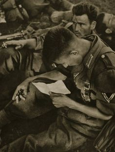 A German soldier reads a letter from home.