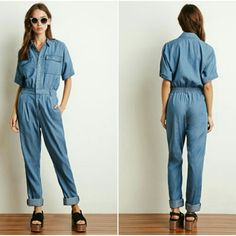 """Forever 21 Chambray Utility Jumpsuit F21 blue chambray lightweight jumpsuit in light denim color Size small Worn once. Love it but decided I am not crazy about the fit of it on me. Great condition. A few loose threads, consistent w F21 quality.  Buttons up the bodice. 63% lycocell 23% poly 14% cotton 33"""" inseam Forever 21 Pants Jumpsuits & Rompers"""