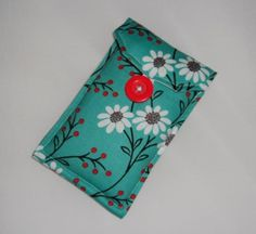 This listing is for a lightly padded phone cover made from teal fabric with daisies on it. You can have a choice of fastening for your cover, either a button and elastic as seen in the photos, or velcro. Teal Fabric, Free Uk, Phone Cover, Daisies, Floral Tie, June, Jewels, Board, Margaritas