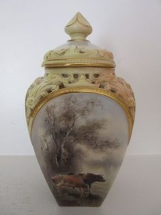 A ROYAL WORCESTER POT POURRI WITH CATTLE PAINTED DECORATION BY J STINTON