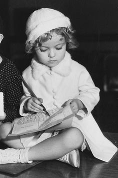 Shirley Temple signs her first film contract, 1932