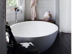 Private Oasis: Cozy cottage inspired bathroom with large soaking tub. Very cute.