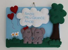 "Quadrinho ""#Amor, meu grande amor"" com um lindo #casal de #elefantes. Feito em tecido e #feltro. Wall art ""My greatest #love"" showing a lovely #elephant #couple made with #felt and fabric."