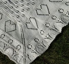 Lace baby blanket with little hearts free knit pattern. A charming baby blanket worked like a traditional Shetland shawl. Free Pattern