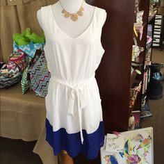 Blue and White ColorBlock dress Very pretty!  Tie around the waist and pockets!  100% polyester. Pink Owl Dresses Midi