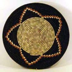 Africa | Millet Fruit Basket.  Uganda | The dyes used are made from berries, plants, and other materials found in nature.