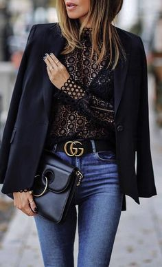 A sharp structured jacket designed just for fashion trailblazers; Gucci belt, denim jeans, and lace sheer shirt