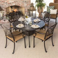 This cast aluminum patio dining set by Lakeview is inspired by intricate scrollwork and careful detailing for a classic decorative style. Featuring long-lasting Sunbrella fabric. Click to browse more of our patio collections to find your perfect style.
