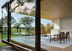 US firm Desai Chia Architecture used prefabricated elements to construct this glass and steel home in rural New York that serves as as a weekend retreat