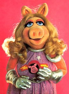 Miss Piggy - I had her poster above my bed.  I didn't know there was a  Muppet Wiki, fun!