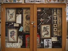 """Display case holding various antique machines, Doc Forbes pre-WW II flash, Sailor Pancho """"Tattoos window Sign"""""""