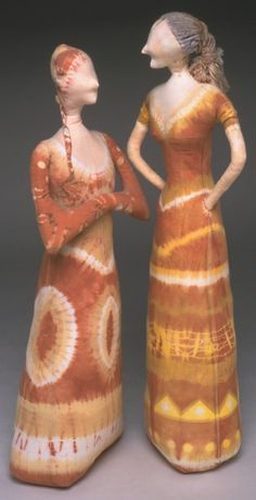 """I used all the onion skins saved for over a year to dye this soft sculpture of two women, """"The Conversation"""". The postures of these characters was based on my most common memories of my mother and my aunt in earnest conversations during our frequent family get-togethers. Before dyeing the cotton muslin, I separated the three different colors of onion skins I had saved, from yellow to dark red, and dip dyed the surface designs."""