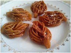 Bouchnikas - intricate Algerian fried pastries.