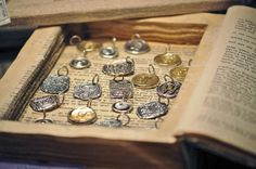 Clever! These would be perfect for storybook charms, poetry pendants, initials and monograms, etc.  (Great resource for retail gift displays from Gift Shop Magazine)