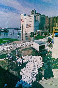 Sandbagging in Alton ILL during the flood of 1993. Note the grain dryers and storage silos in the background.