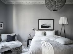 Light grey bedroom with monochromatic decor. Are you looking for unique and beautiful art photo prints to curate your art wall? Visit bx3foto.etsy.com and follow us on Instagram @bx3foto