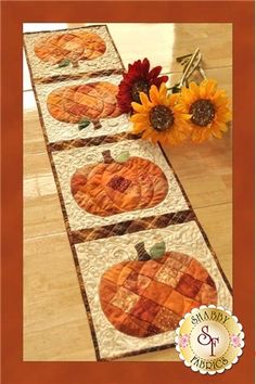 Patchwork Pumpkin Table Runner Pattern: Create a darling table runner using your orange scraps! This Shabby Fabrics Exclusive finishes to 12 1/2