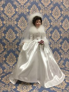 WINTER ROMANCE. First issue in the She Walks in Beauty collection of porcelain bride dolls Sculpted by artist Sandra Bilotto in an exclusive edition for the Ashton-Drake Galleries.