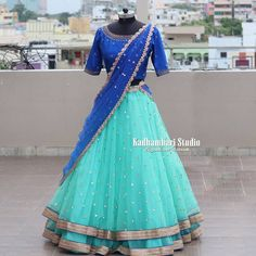 Beautiful deep blue color designer blouse with floral design hand embroidery gold thread and stone work. Sea green color designer lehenga with net dupatta. Half Saree Designs, Choli Designs, Blouse Designs, Indian Long Dress, Indian Gowns Dresses, Long Frocks For Girls, Dresses Kids Girl, Half Saree Lehenga, Green Lehenga