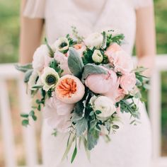 This muted #bouquet is full of some of our faves: #anemone #ranunculus #veronica #peonies and #gardenroses! #weddingbouquet | Photography: @emilydelamater | Floral Design: Minka Fine Flowers | Wedding Dress: @verawanggang by smpweddings
