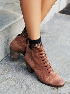 Loveland Ankle Boot | A classic style gets a cool update in this suede ankle boot featuring a chunky block heel for a comfortable step. Textured design at the heel with subtle cutout accents and a front braided look.