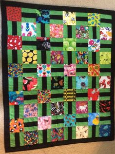 I spy quilt with green and black - later I attached ties to the end so it can be rolled up like a sleeping bag.