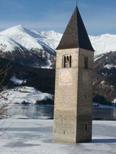 Clock tower in Graun-Curon, Reschensee, Italy