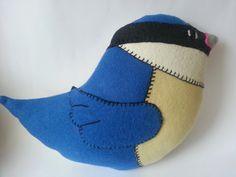 Blue bird cushion by madebyswimmer on Etsy, £25.00