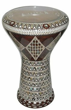 """DOUMBEK DRUM GAWHARET EL FAN Mother of Pearl 17"""" Drum by GAWHARET EL FAN. $249.00. This is a beautiful new 17"""" darbuka. Comes with a clear synthetic head and a premium case. This drum is a top quality drum!  The Beautiful and intricate inlay of real mother of pearl and the beautiful patterns make this drum a real work of art.  Classic wooden style, absolutely amazing!     This drum is a top quality drum!  6 bolts head drum  Padded premium case and 1 extra synthet..."""