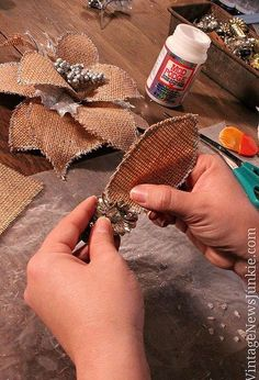 how to make a burlap flower christmas ornament video tutorial, crafts, decoupage, seasonal holiday decor, Attach leaves to your base I used some vintage Christmas ornaments I picked up at a yard sale