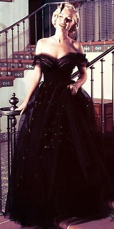 Marilyn Monroe, 1951 off-the-shoulder vintage ball gown - the black is perfect for her.